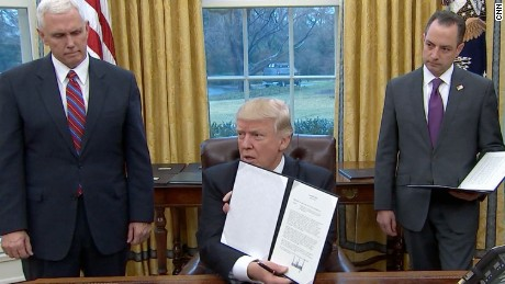 President Trump after signing executive actions in the first day of his presidency.