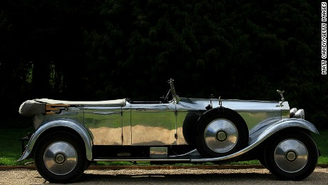 WINCHESTER, ENGLAND - APRIL 16: The sun catches on the panels of a 1928 Rolls Royce Phantom at Northington Grange, the summer home of the Grange Park Opera, on April 16, 2011 near Winchester, England. The English Heritage Grade 1 listed Greek Revival style property was the setting for the inter-war Rolls Royce20-Ghost Club members which was founded in 1949 by a group of owners of vintage Rolls Royce cars. (Photo by Matt Cardy/Getty Images)