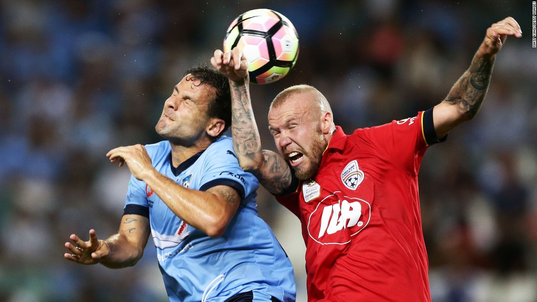 Sydney FC striker Bobo, left, competes for a header with Adelaide United defender Taylor Regan on Friday, January 20.