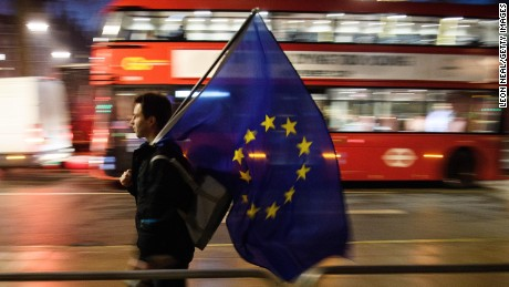 LONDON, ENGLAND - JANUARY 24:  A man carries a European Union flag outside the Supreme Court in Parliament Square ahead of the ruling on whether Parliament have the power to begin the Brexit process, on January 24, 2017 in London, England. The judgement will play an important role in how the Government proceeds with it's planned use of the EU's Article 50 exit clause.  (Photo by Leon Neal/Getty Images)