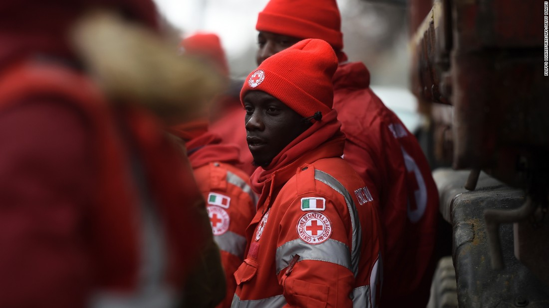 Migrants volunteering with the Italian Red Cross stand ready at the avalanche emergency operations center at Penna, central Italy, on Saturday, January 21.