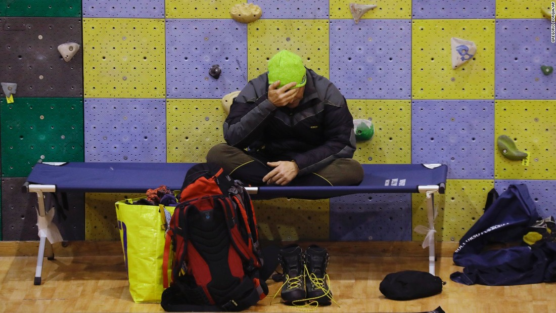 A rescuer rests at a sports complex turned emergency coordination center in Penne on January 21.