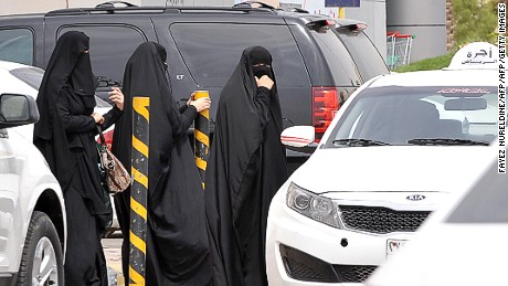 Saudi women leave a mall in the capital Riyadh in 2014, when activists urged women to defy a traditional driving ban and get behind the wheel.