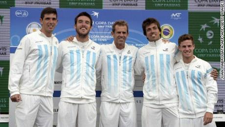 Argentina's Copa Davis team (L-R) tennis players Federico Delbonis, Leonardo Mayer, captain Daniel Orsanic, Carlos Berlocq and Diego Schwartzman pose  during the draw ahead of their Davis Cup World Group 1st Round double tennis match in Villa Martelli, Buenos Aires, Argentina on March 5, 2015. AFP PHOTO / JUAN MABROMATA        (Photo credit should read JUAN MABROMATA/AFP/Getty Images)