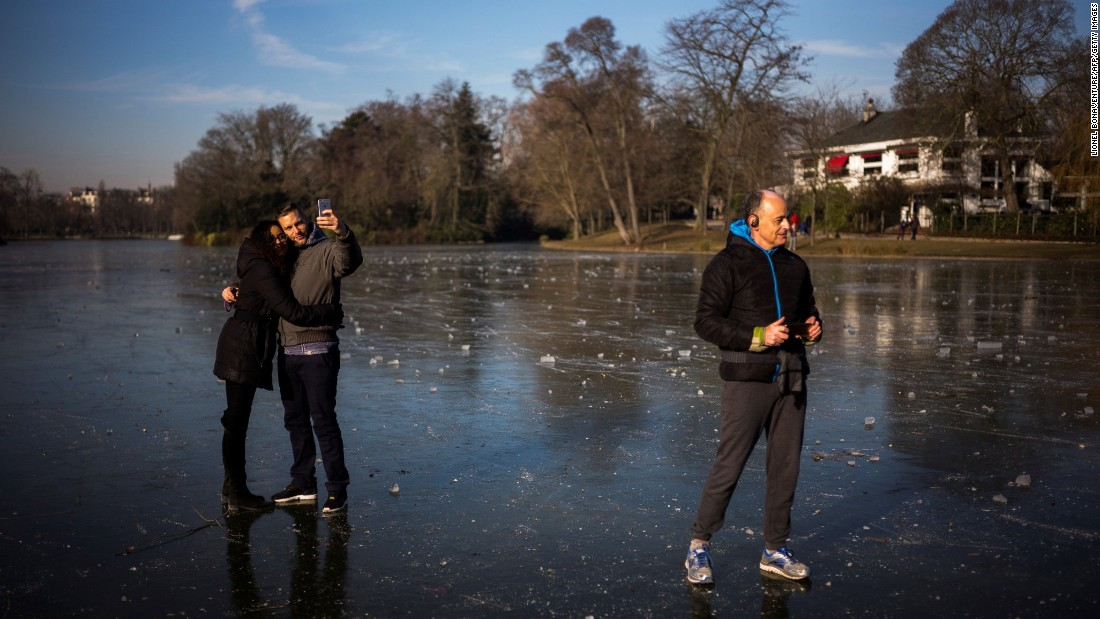 A couple takes a selfie on a frozen Paris lake on Sunday, January 22.