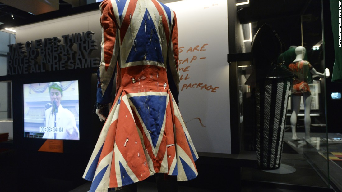 "Designed for David Bowie for the 1996 VH1 Fashion Awards, the now iconic ""Union Jack"" frock with its frilly black-lace cuffs is one of Alexander McQueen's earliest designs. The theme was revisited in his later creations, including scarves and clutch bags carrying the distinct red, white and blue colors of the Union flag.<br />"