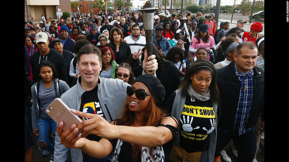 Phoenix Mayor Greg Stanton holds a torch Monday, January 16, during the city's annual march on Martin Luther King Jr. Day.