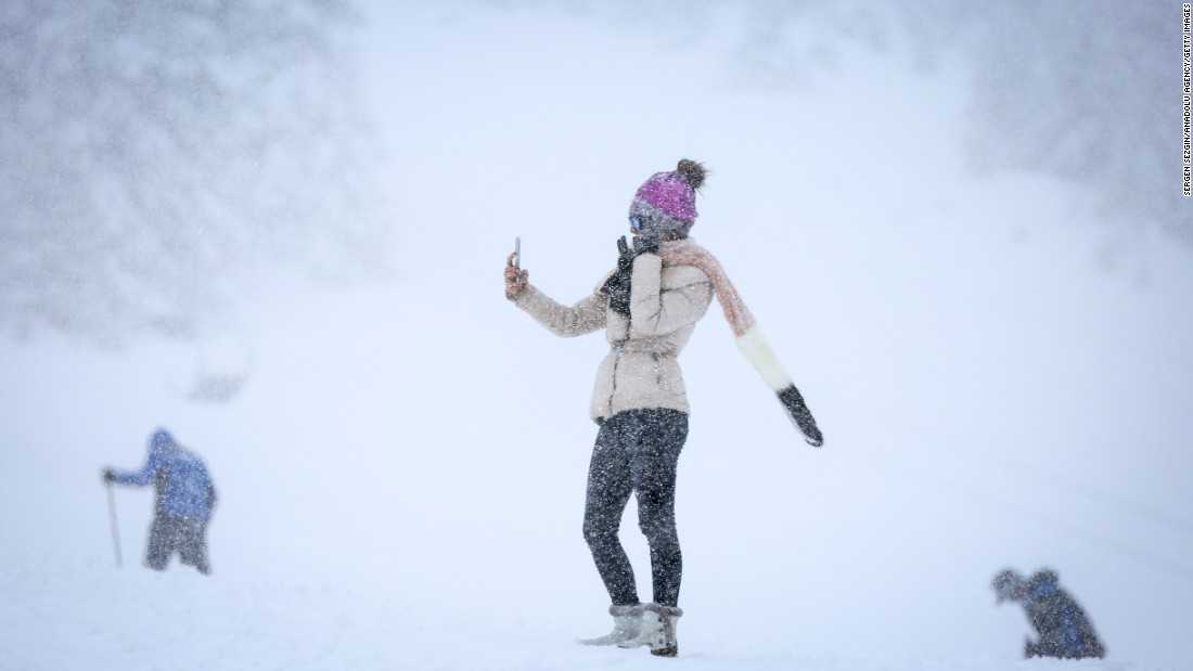 A woman takes a selfie on Uludag, a Turkish mountain that is a popular spot for winter sports, on Tuesday, January 17.