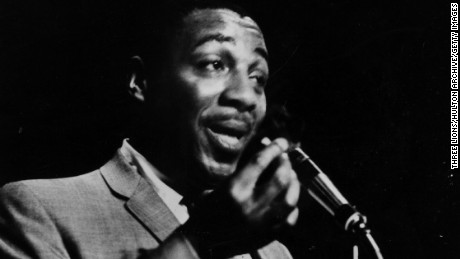 Black comedian Dick Gregory at the microphone, 1962.  (Photo by Three Lions/Getty Images)