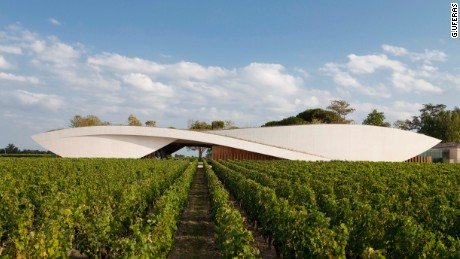 Château Cheval Blanc, Bordeaux -- Designed by French architect Christian de Portzamparc, this prestigious cellar rises from a grass hill as if it's a part of the scenery. The curvaceous concrete structure houses a 64,583-square-foot, light-filled cellar stocked with 52 enormous cement vats -- ranging from 20 to 110 hectolitres in volume.