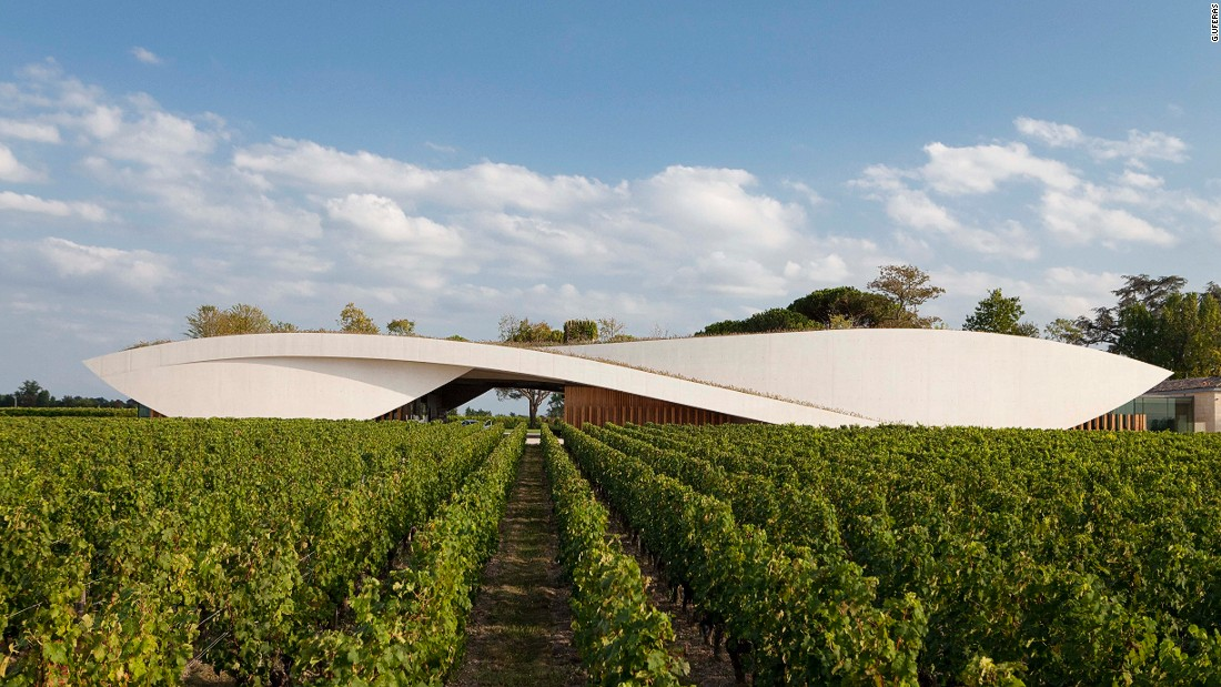 Designed by French architect Christian de Portzamparc, this prestigious cellar rises from a grass hill as if part of the scenery. The curvaceous concrete structure houses a 64,583 square foot cellar stocked with 52 enormous cement vats that range in capacity from 20 to 110 hectoliters.