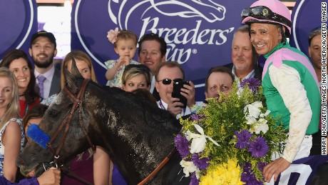 Jockey Mike Smith riding Arrogate celebrates after winning the Breeders' Cup Classic race on day two of the 2016 Breeders' Cup World Championships at Santa Anita Park on November 5, 2016 in Arcadia, California.