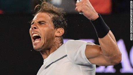 TOPSHOT - Spain's Rafael Nadal celebrates his victory against France's Gael Monfils during their men's singles fourth round match on day eight of the Australian Open tennis tournament in Melbourne on January 23, 2017. / AFP / SAEED KHAN / IMAGE RESTRICTED TO EDITORIAL USE - STRICTLY NO COMMERCIAL USE        (Photo credit should read SAEED KHAN/AFP/Getty Images)