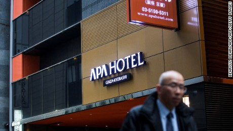 "A man walks past the entrance of an APA hotel in central Tokyo on January 20, 2017. Japanese organisers of next month's Asian Winter Games in Sapporo look set to remove inflammatory literature denying a wartime massacre of Chinese civilians from hotel rooms housing visiting athletes. One of Japan's largest hotel chains sparked an angry backlash from China after placing a book in guest rooms which claimed the infamous 1937 Nanjing Massacre committed by Japanese troops was a ""fabrication.""  / AFP / Behrouz MEHRI        (Photo credit should read BEHROUZ MEHRI/AFP/Getty Images)"
