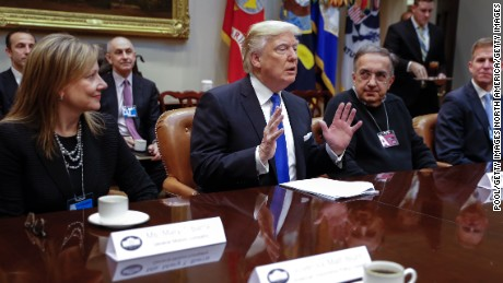 WASHINGTON, DC - JANUARY 24: (AFP-OUT) President Donald Trump meets with CEO of General Motors Mary Barra (L), CEO of Fiat Chrysler Automobiles Sergio Marchionne (2nd R) and Fiat Chrysler Head of External Affairs Shane Karr (R) in the Roosevelt Room of the White House on January 24, 2017 in Washington, DC. President Trump has a full day of meetings including one with Senate Majority Leader Mitch McConnell and another with the full Senate leadership. (Photo by Shawn Thew-Pool/Getty Images)