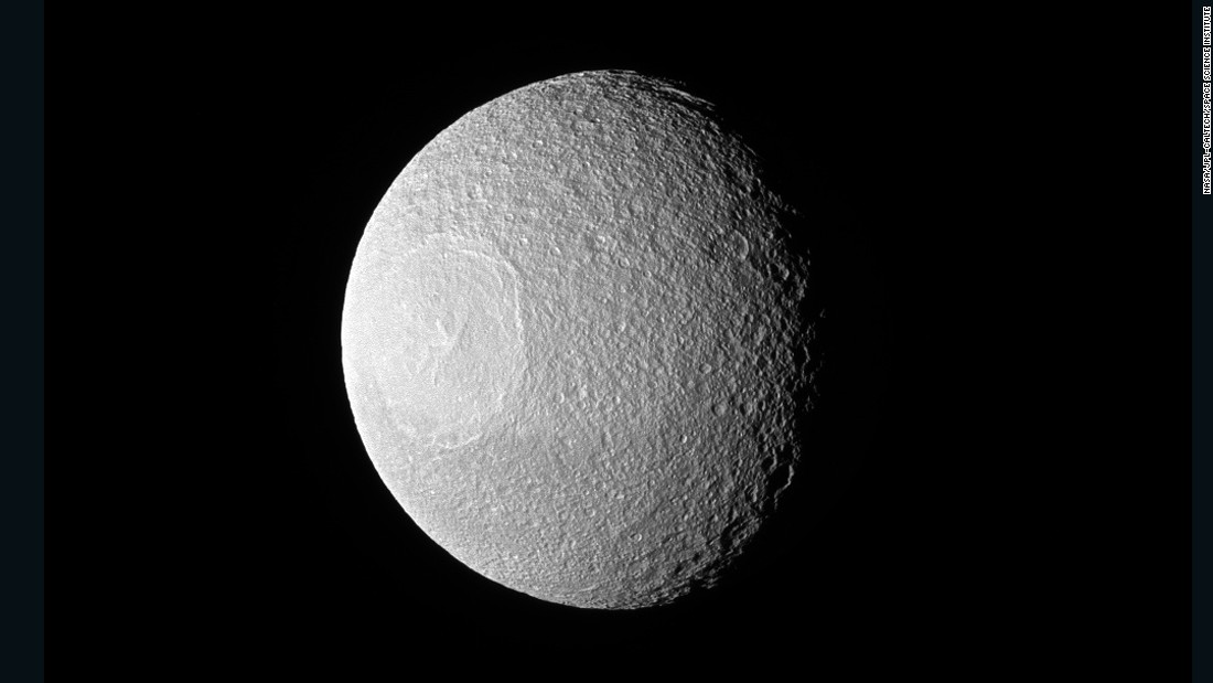 "This photo of Saturn's large icy moon, Tethys, was taken by NASA's Cassini spacecraft, which has been sending back some<a href=""http://www.cnn.com/2014/06/27/tech/gallery/cassinis-top-discoveries/"" target=""_blank""> jaw-dropping images</a> from the ringed planet."