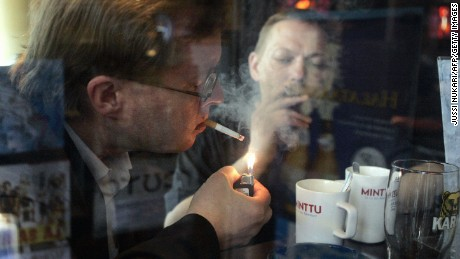 Helsinki, FINLAND: Men smoke cigarettes in a bar in Helsinki 31 May 2007. Finland will become 01 June 2007 the latest European nation to ban smoking in bars and restaurants, a measure that is expected to be introduced fairly painlessly in the tobacco-critical state. AFP PHOTO / LEHTIKUVA / Jussi Nukari  FINLAND OUT (Photo credit should read JUSSI NUKARI/AFP/Getty Images)
