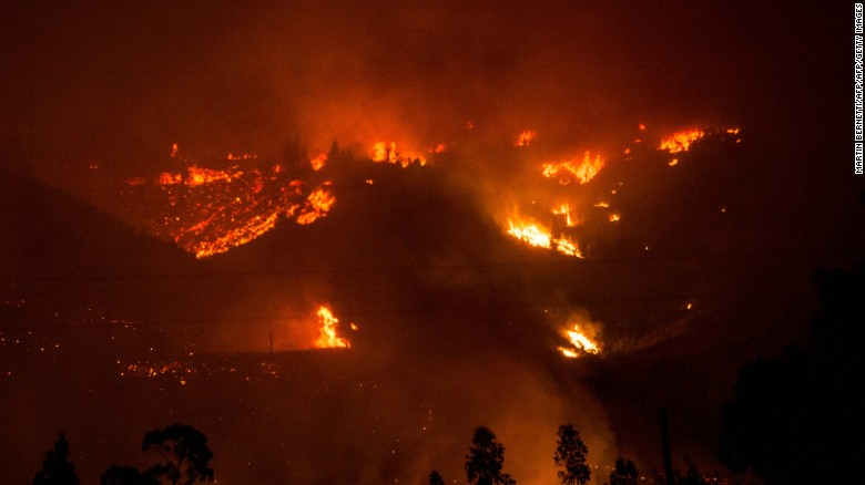 Forest fires consume parts of the community of Vichuquen in Chile's Maule Region.