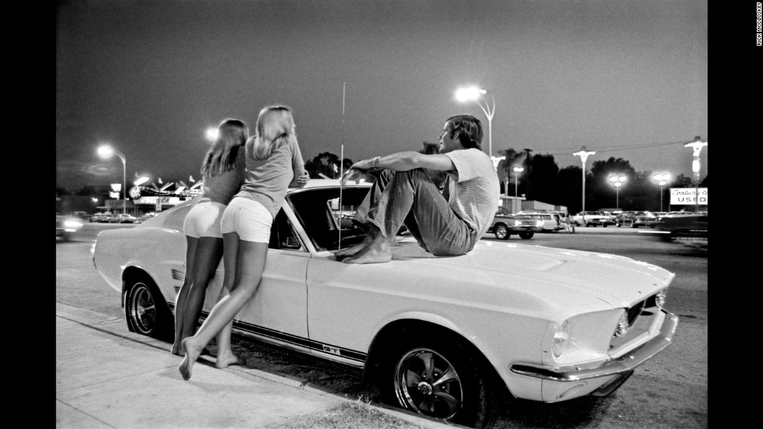 "Young people hang out on Los Angeles' Van Nuys Boulevard in summer 1972. Wednesday nights were ""cruise nights,"" recalled photographer Rick McCloskey. ""You had everything from your Mustangs to lowriders and hot rods. ... Essentially you were out there to see your friends, show off your car and just sort of <em>be there</em>. It was the place for young people to be."" McCloskey's photos are part of <a href=""http://www.rarebirdbooks.com/los-angeles-in-the-1970s/"" target=""_blank"">""Los Angeles in the 1970s,""</a> a collection of essays recently published by Rare Bird Books."