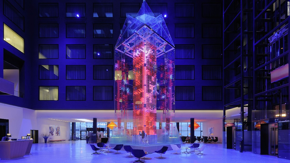 "A 54-foot-high glass wine tower -- the world's tallest -- brings the atrium of Zurich Airport's Radisson Blu hotel to life. Housing 4,000 bottles, it is staffed by resident aerial artist ""Wine Angels,"" who will recommend pairings and 'fly' up the tower to fetch your selection."