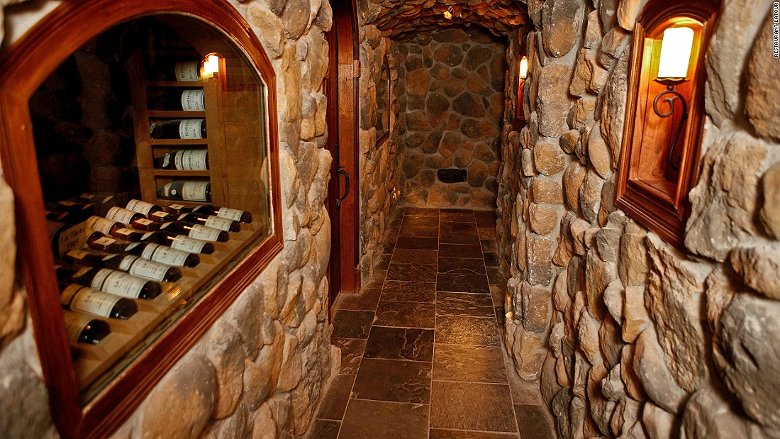 To access the cellar, guests climb down a spiral wrought-iron staircase that's hidden behind an unmarked door. The steep, narrow climb leads to the low-lit cellar, where two intimate dining rooms provide an atmospheric spot for private tastings.
