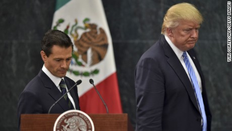 US presidential candidate Donald Trump (R) and Mexican President Enrique Pena Nieto prepare to deliver a joint press conference in Mexico City on August 31, 2016. Donald Trump was expected in Mexico Wednesday to meet its president, in a move aimed at showing that despite the Republican White House hopeful's hardline opposition to illegal immigration he is no close-minded xenophobe. Trump stunned the political establishment when he announced late Tuesday that he was making the surprise trip south of the border to meet with President Enrique Pena Nieto, a sharp Trump critic.  / AFP / YURI CORTEZ        (Photo credit should read YURI CORTEZ/AFP/Getty Images)