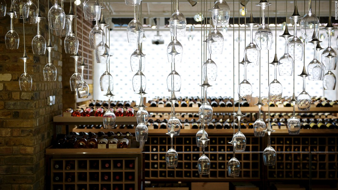 Under a lighting fixture featuring hundreds of Riedel wine glasses, this London boutique carries wines ranging from everyday bottles to unique collectables.