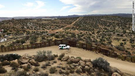 A US Border Patrol vehicle stands guard along the US-Mexico border on September 26, 2016, in Jacamba Hot Springs, California. According to a Congressional Research report, the first fencing was constructed near San Diego in 1990.
