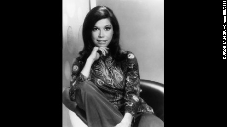circa 1968:  Portrait of American actor Mary Tyler Moore sitting on a chair in a peacock feather print blouse.  (Photo by Hulton Archive/Getty Images)