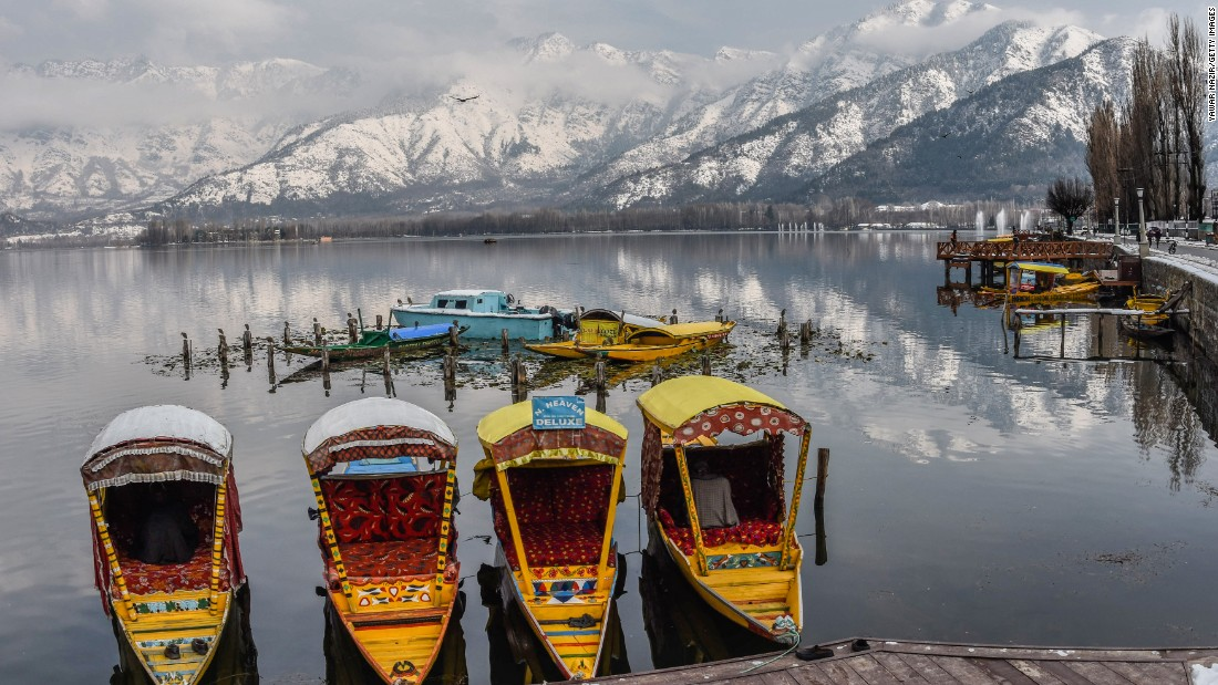 <strong>Srinagar, Kashmir: </strong>Traditional wooden shikara boats are moored in the popular Dal Lake tourist spot. The Zabarwan mountain range lies beyond.