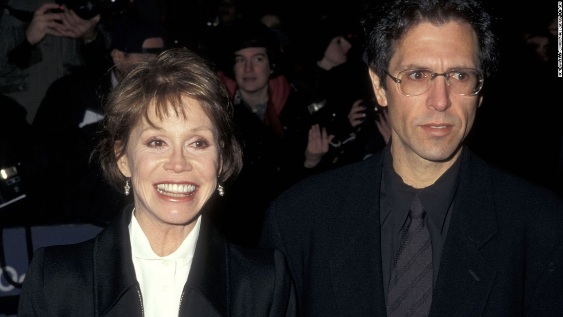 "Moore and her third husband, Robert Levine, attend the New York premiere of ""The English Patient"" in 1996. She was married to Levine when she died."