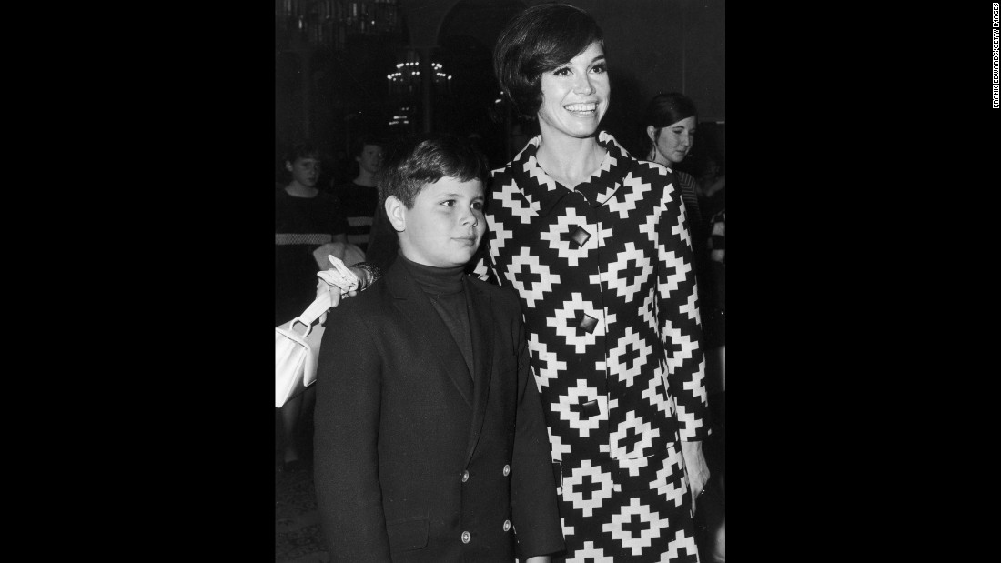 Moore puts her arm around her son, Richard, at a Teach Foundation benefit in 1968. Richard, Moore's only child, died in 1980 after he accidentally shot himself while handling a shotgun.
