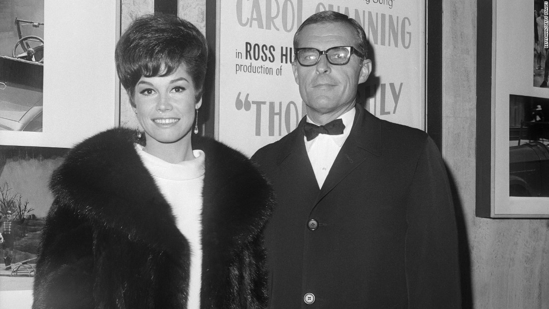 "Moore and her second husband, Grant Tinker, attend the premiere of ""Thoroughly Modern Millie."" The two started the television production company MTM Enterprises, which produced ""The Mary Tyler Moore Show"" as well as such acclaimed series as ""The Bob Newhart Show,"" ""Hill Street Blues"" and ""St. Elsewhere."""