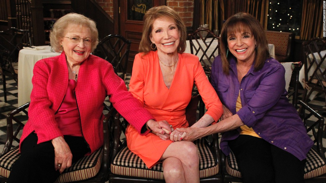 "From left, Betty White, Moore and Valerie Harper sit together at a 2013 reunion of cast members from ""The Mary Tyler Moore Show."""