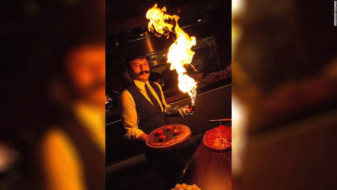 <strong>On fire: </strong>One of Nusr-et's signature dishes, beef sushi, is cooked table-side by blowtorch.