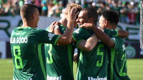 Chapecoense's player Amaral (2nd R) celebrates with teammates after scoring against Palmeiras, during a friendly football match held at  Arena Conda stadium in Chapeco, Santa Catarina state, in southern Brazil on January 21, 2017. Most of the members of the Chapocoense football team perished in a November 28, 2016 plane crash in Colombia. / AFP / NELSON ALMEIDA        (Photo credit should read NELSON ALMEIDA/AFP/Getty Images)