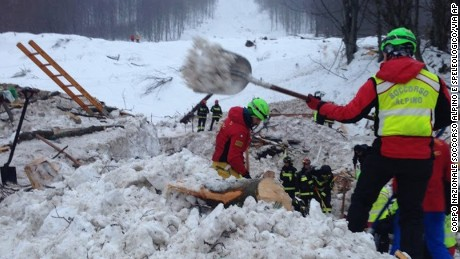 Volunteers and rescuers work Wednesday at the scene of the Hotel Rigopiano avalanche.