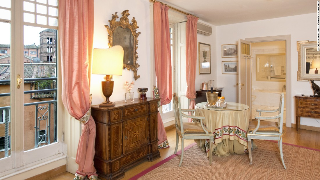 The Princess Pia suite at the Residenza Ruspoli Bonaparte features a living room, a master bedroom, a second bedroom with two single beds and two private bathrooms.