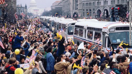 (Original Caption) Washington: Buses carrying the 52 former American hostages from Iran are mobbed by well wishers on Pennsylvania Avenue in Washington 1/27.