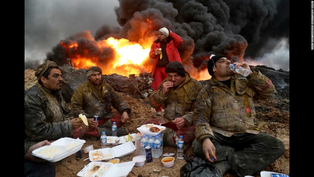 "Firefighters take a break from trying to extinguish oil wells in Qayyara, Iraq, on Wednesday, January 25. ISIS militants set oil wells on fire as they were pushed out by an Iraqi-led coalition <a href=""http://www.cnn.com/2016/10/17/world/gallery/mosul/index.html"" target=""_blank"">trying to reclaim the region.</a>"