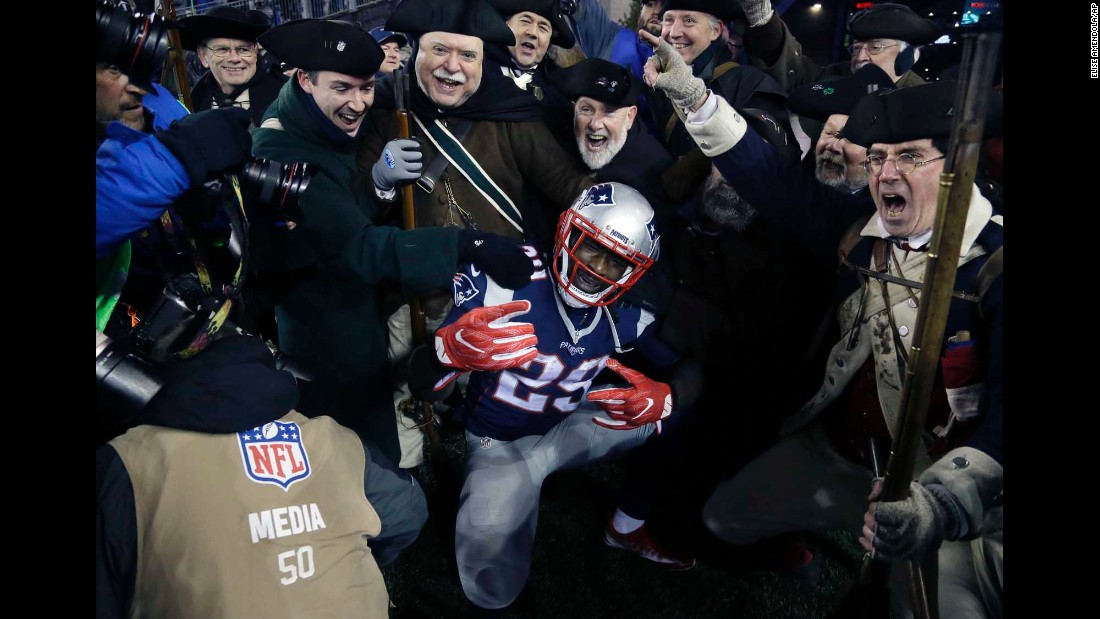 "LeGarrette Blount, a running back for the New England Patriots, celebrates a touchdown with costumed fans during the NFC Championship on Sunday, January 22. The Patriots defeated Pittsburgh 36-17 <a href=""http://www.cnn.com/2017/01/22/us/nfl-playoffs-nfc-and-afc-championship-games/"" target=""_blank"">to advance to the Super Bowl.</a>"