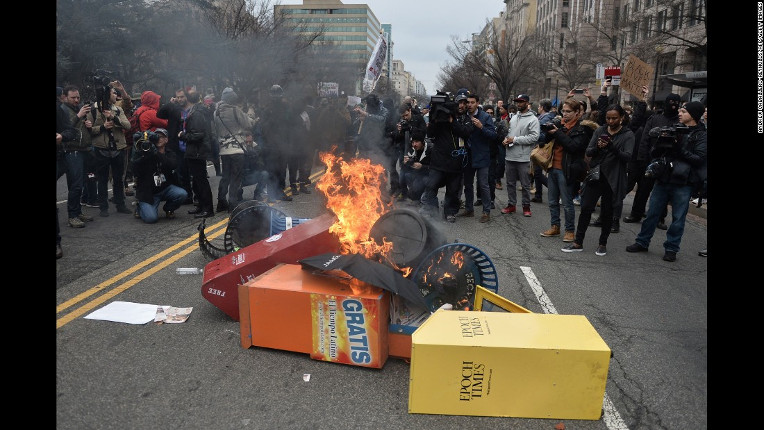 "Demonstrators set fires in Washington as they protest the inauguration of Donald Trump on Friday, January 20. <a href=""http://www.cnn.com/2017/01/19/politics/trump-inauguration-protests-womens-march/"" target=""_blank"">Six police officers were injured and 217 protesters were arrested that day</a> after a morning of peaceful protests gave way to ugly street clashes in downtown Washington."