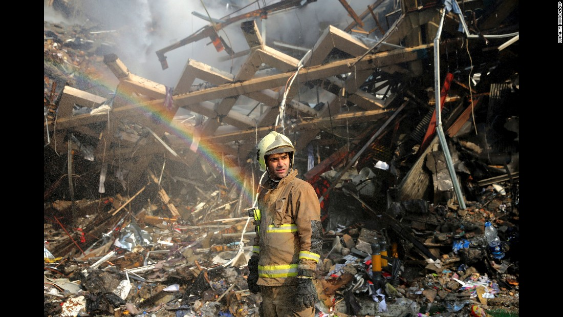 "A rainbow appears as a firefighter removes debris from a building in Tehran, Iran, on Friday, January 20. More than 20 firefighters were killed when <a href=""http://www.cnn.com/2017/01/19/middleeast/iran-tehran-building-fire-collapse/"" target=""_blank"">a multi-story building collapsed</a> as they were battling a blaze, the city's mayor told Iranian state TV."