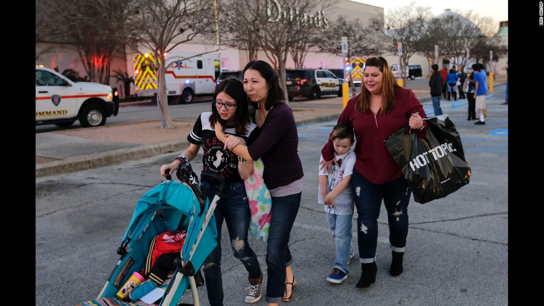 "Shoppers react after police helped them exit a San Antonio mall after <a href=""http://www.cnn.com/2017/01/23/us/san-antonio-mall-shooting-2-face-murder-charge-in-death-of-good-samaritan/"" target=""_blank"">a deadly shooting there</a> on Sunday, January 22. Police say two men tried to rob a jewelry store. Shopper Jonathan Murphy tried to intervene and was fatally shot. The two suspects are in custody."