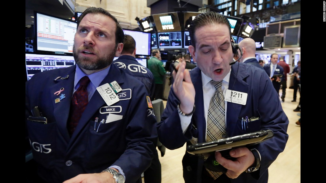 "Specialist Michael Pistillo, left, and trader Tommy Kalikas work on the floor of the New York Stock Exchange on Monday, January 23. <a href=""http://money.cnn.com/2017/01/25/investing/dow-20000-stocks/"" target=""_blank"">The Dow reached 20,000</a> this week for the first time ever."