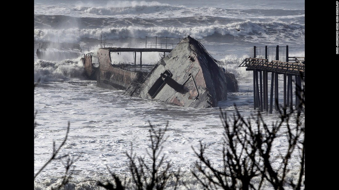 Waves crash into the SS Palo Alto, a World War I-era ship that was torn apart by a storm in Aptos, California, on Saturday, January 21.