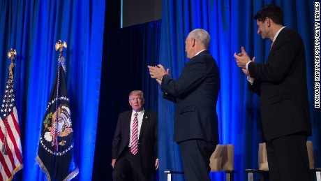US House Speaker Paul Ryan (R) and US Vice President Mike Pence (2nd R) applaud US President Donald Trump as he arrives to address a Republican retreat in Philadelphia on January 26, 2017  / AFP / NICHOLAS KAMM        (Photo credit should read NICHOLAS KAMM/AFP/Getty Images)