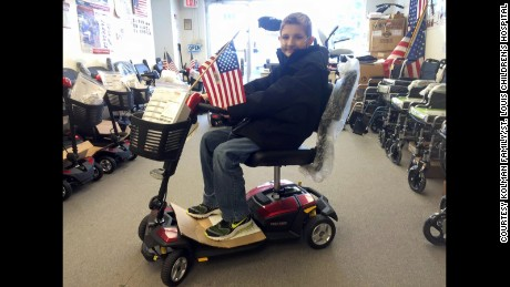 Spencer Kolman used a scooter to get to his high school classes.