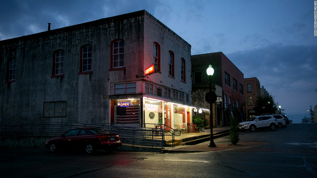Night falls on the Corner Liquor Store, which has been serving Brenham since the 1940s.