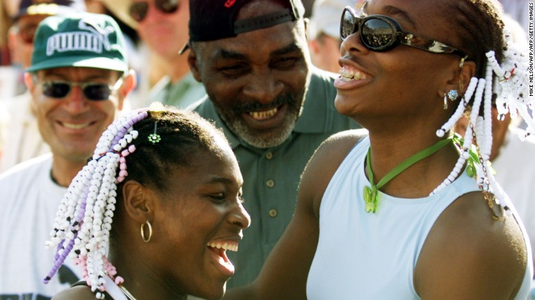 Serena (L) celebrates with sister Venus (R) and father Richard (C) after beating Steffi Graf in a 1999 final.